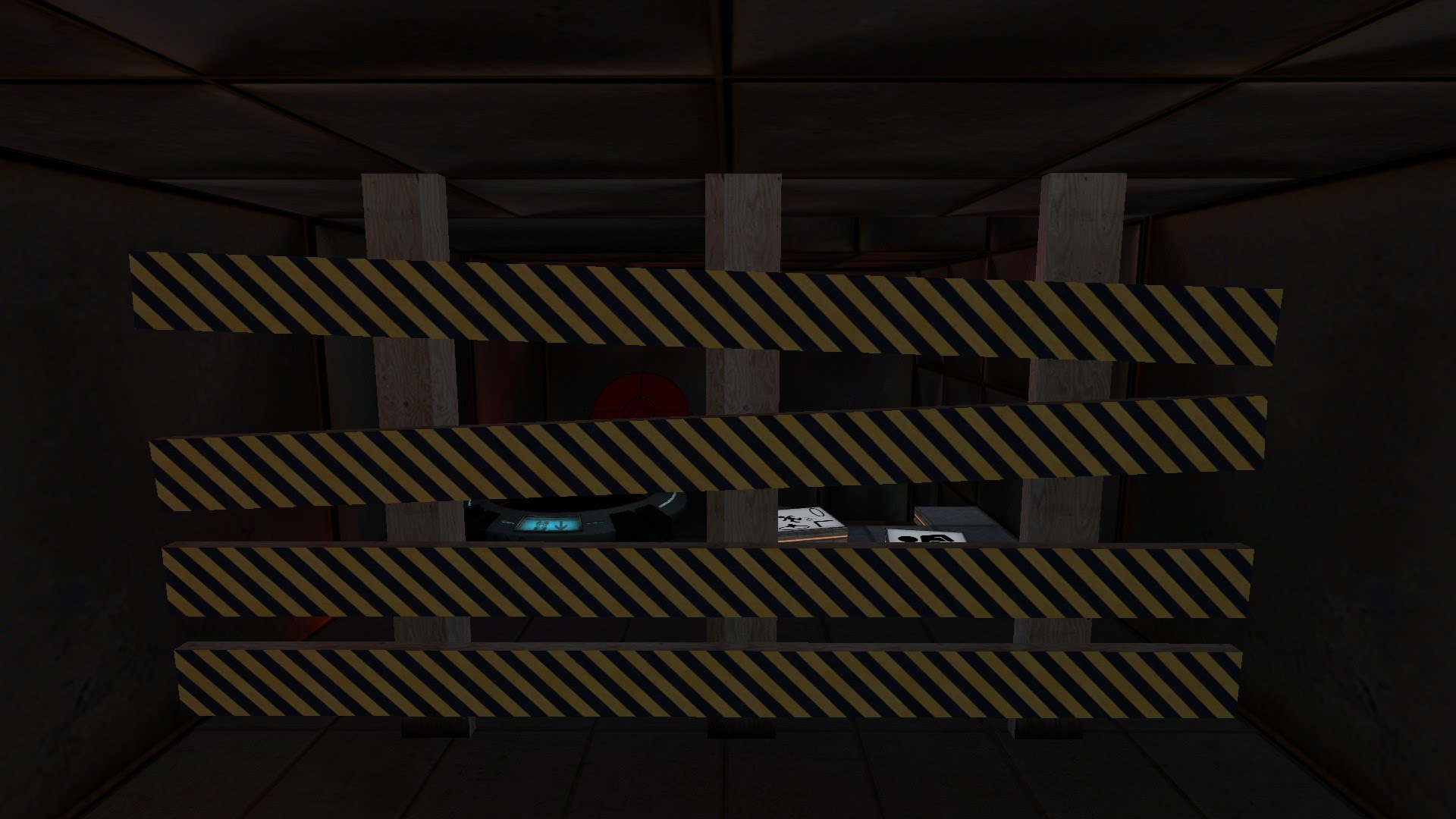 A test chamber under construction is blocked off by a caution barrier.